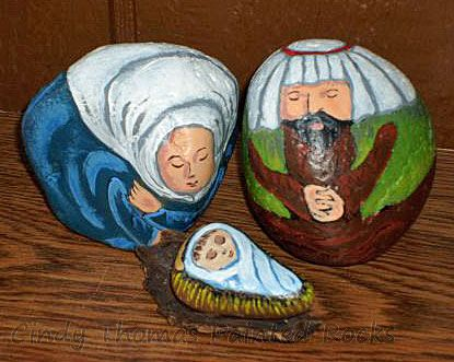 Medium-sized rocks painted as Nativity scene figures